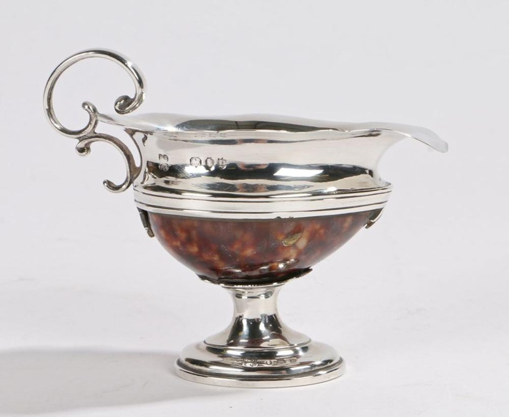 Victorian silver and cowrie shell jug, London 1890, maker B.B P.R, with double C scroll handle and w