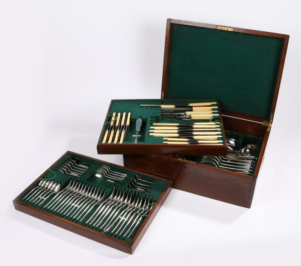 Canteen of plated table cutlery, with place settings for six, the three fitted interior trays housed