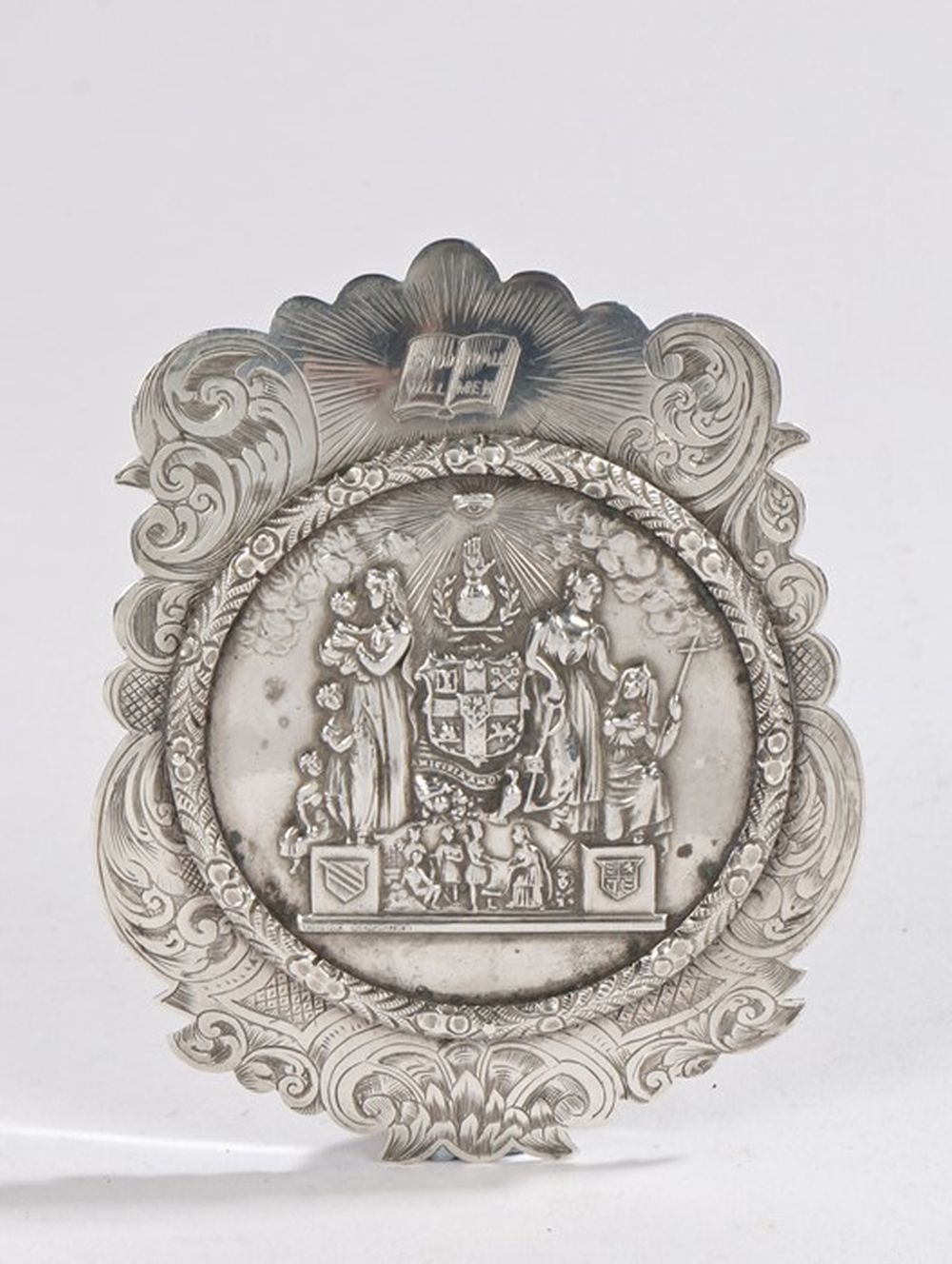 Masonic interest- a Victorian silver pendant, Birmingham 1870, maker George Unite, the scroll engrav