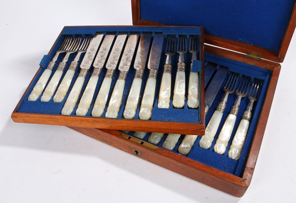 Canteen of 19th Century fruit knives and forks, with mother of pearl handles, the blades and tines w