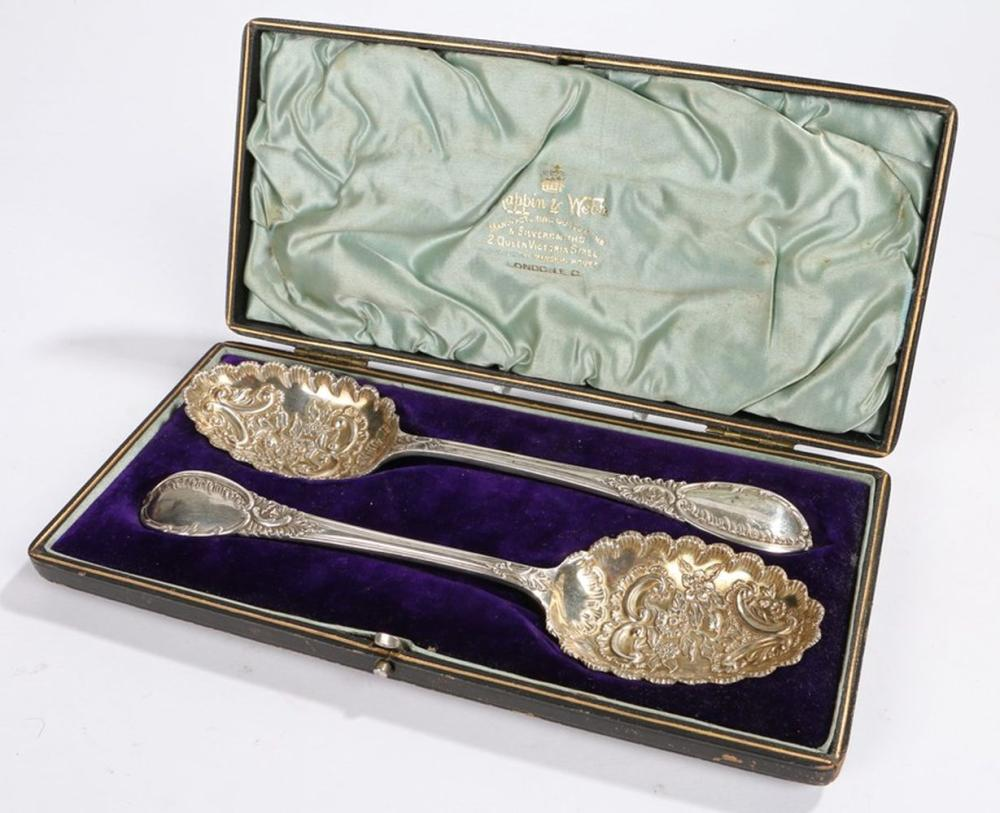 Pair of Mappin & Webb plated serving spoons, the bowls with foliate and scroll decoration, the handl