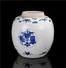 Chinese porcelain ginger jar of large proportions, possibly Kangxi period, with rib effect and decorated with blue panels of symbols and emblems, top and bottom border with similar decoration, the base with twin circles and palm leaf in the centre,