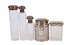 SET OF FIVE DRESSER BOTTLES WITH STERLING LIDS