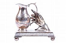AN UNUSUAL VICTORIAN SILVERPLATED DESK ORNAMENT