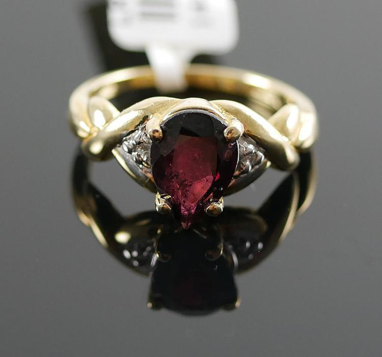 14K YG GARNET AND DIAMOND RING