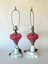 Pair of cranberry and milk glass table lamps, 28 inches tall. Condition: good.