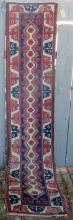 Vintage Caucasian long rug, 109 by 22 inches. Condition: good.