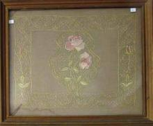 Antique needlepoint of roses, 19 by 22.5 inches, framed.
