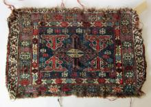 Antique Oriental bag face, 18 by 28 inches. Condition: edge losses.