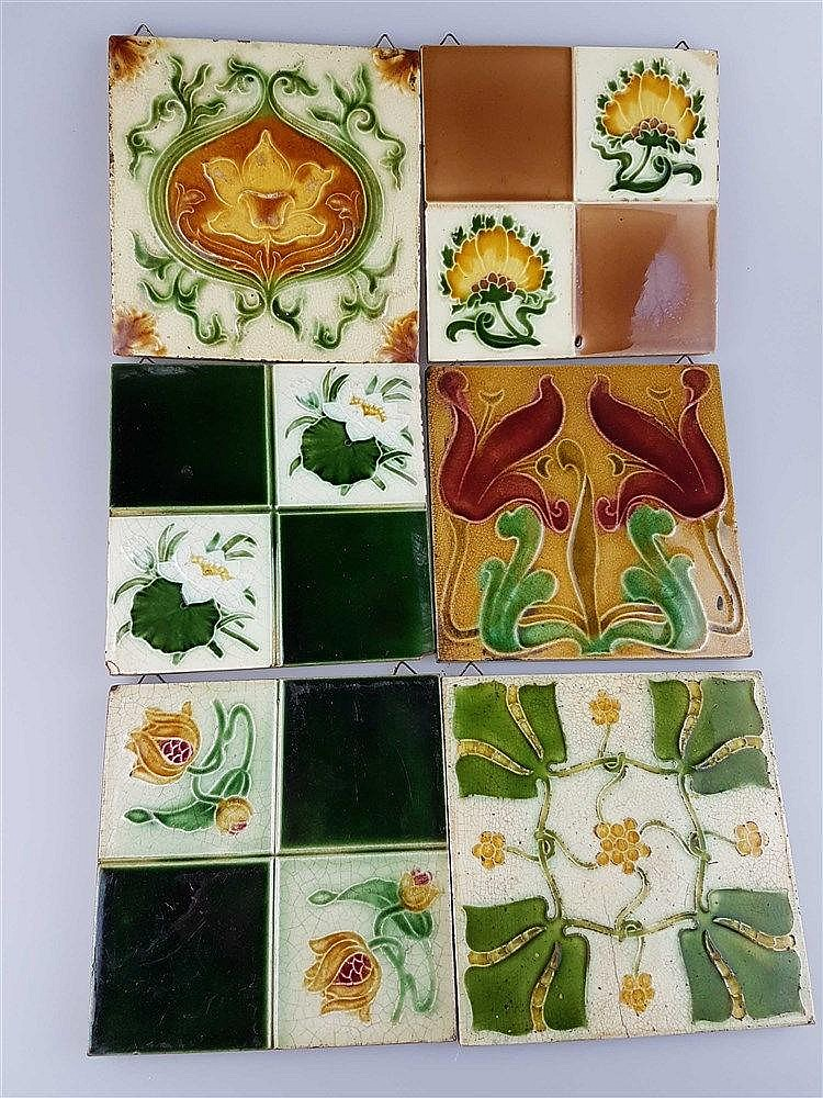6 Jugendstil-Kacheln - Keramik,mit floralen Motiven, Glasur krakeliert u. partiell lt.best., z.T.aus England, ca. 15,3x15,3cm