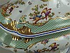 Terrine - Frankreich, handangefertigt und bemalt, stilisierte Vogelmotive und Floraldekor, Teilvergoldung, plastische Handhabe, 1 Seite geklebt, mit minimal. Haarriss, ca.26x35cm