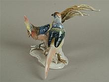 Porzellan-Figur ''Fasanenpaar'' - Ens, grüne Mühlenmarke,vollplastisch ausgeformte Fasanenvögel auf geschweifter vegetabil gestalteter Plinthe,pastellfarben staffiert, H.ca.21,5 cm