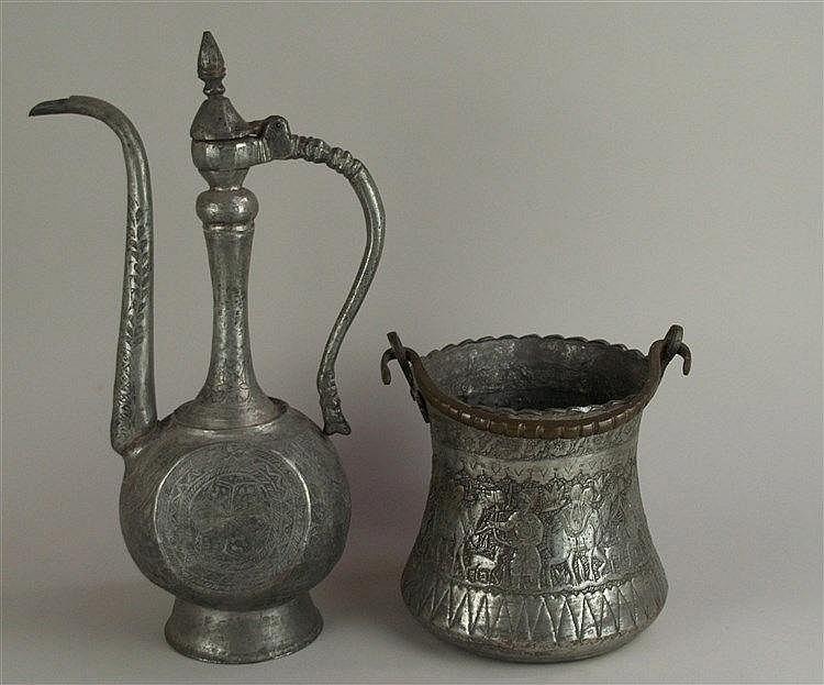 Konvolut Gefäße - Metall,Orient,2-tlg: Kanne mit floralen Ornamenten, H.ca.46cm; Henkeltopf mit Kamel-Dekor, H.mit Henkel ca.33cm, D.ca.18cm