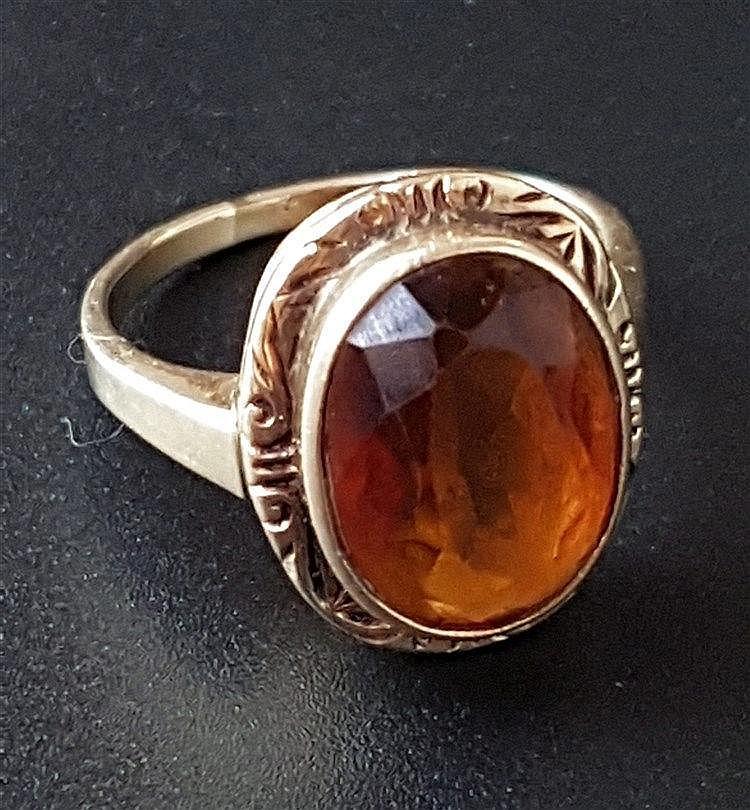 Ring - Gelbgold gestempelt 585,mit facettiertem Hessonit,Ringkopf ziseliert,Gewicht ca.5,3g,Dm.ca.17mm