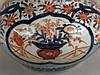 Vase - umlaufender Floraldekor im ostasiatischen Stil, Korallenrot und Blau, Teilvergoldung berieben, H ca.25 cm