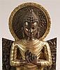 Buddha Shakyamuni auf dem Löwenthron -im Padmasana thronender Buddha Gautama,die Hände im Gestus ''das Rad der Lehre anstoßend'' (dharmacakra-pravartana-mudra),die Geste erinnert an die erste Predigt von Sarnath, in der Buddha die vier Edlen