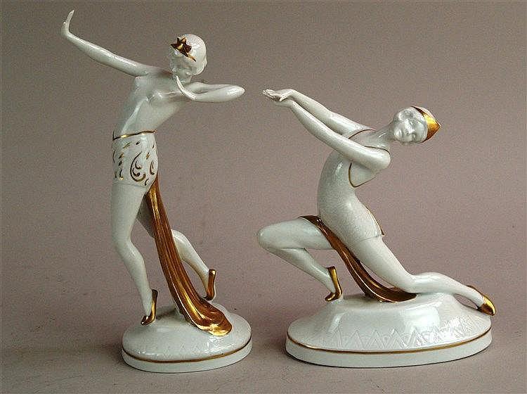 Art-Déco-Tänzerinnen - Bodenmarke Gehren, jeweils auf runder Plinthe, Weißporzellan goldstaffiert, H.ca 23 und 19 cm