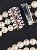 Perlenarmband - 3-reihig, Zuchtperlen ca. 5,5 mm, 835 Silber-Kastenschloss mit Steinbesatz(wohl Rubine),L.ca.18,5cm,min.Tragespuren