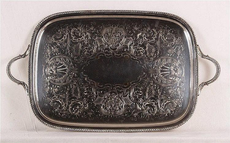 Servierplatte - Metall,versilbert, rechteckige Form mit zwei Griffen,üppig verziert im Rokokostil mit Rocaillen,Akanthusblättern,Voluten und Blüten,Gebrauchsspuren,ca.39x67cm