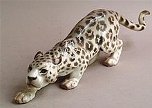 Porzellanfigur ''Jagender Panther'' - Bodenmarke Bing & Grøndahl Copenhagen, farbig staffiert, H.ca.14cm, L.ca.46cm