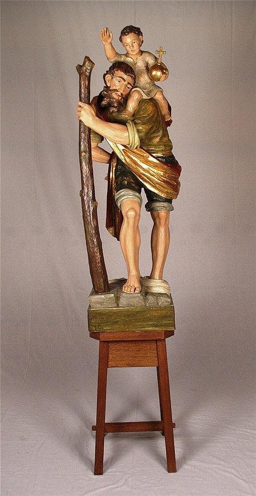 Holzfigur ''Hl.Christophorus mit dem Jesuskind'' - Hl.Christophorus mit dem Holzstab aus dem Wasser heraustretend, Lindenholz, geschnitzt, farbig gefasst tlw. vergoldet, H.ca.135cm, auf viereckigem Sockel ca.12x37x33cm, 20.Jh.