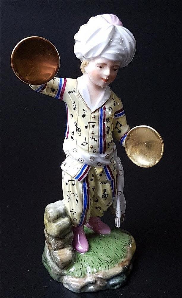 Musiker aus der Türkenkapelle - Hoechst blaue Radmarke mit Malerzeichen, 20.Jh., Entw.Johann Peter Melchior (1747-1825), Tschinellen, polychrom bemalt, gelbe Uniform, H.ca.17cm