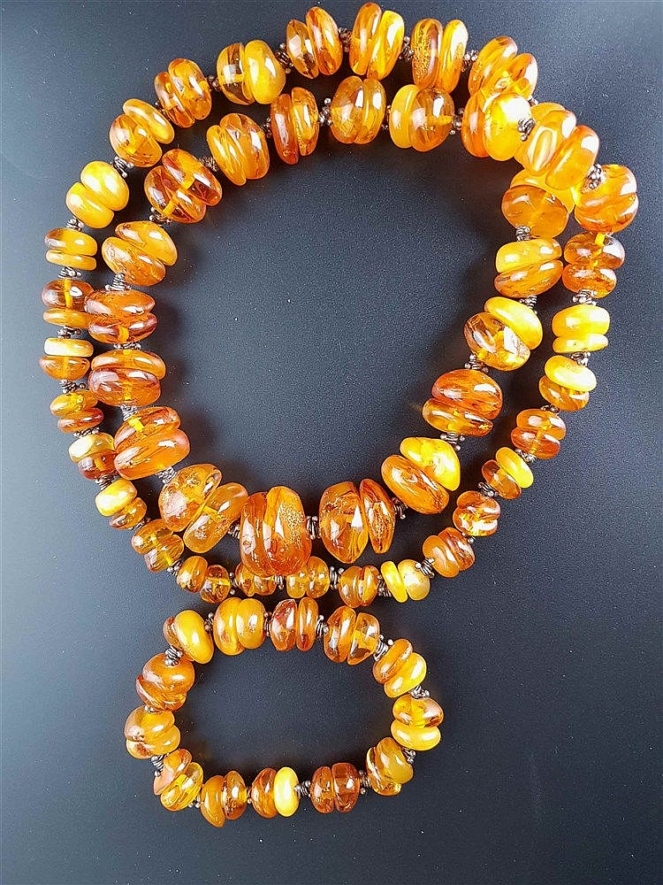 Bernsteinkette und -armband - unregelmäßig geformte Rondelle,Halskette im Verlauf angeordnet,Ges.Gewicht ca.225g,L.ca.90/24cm