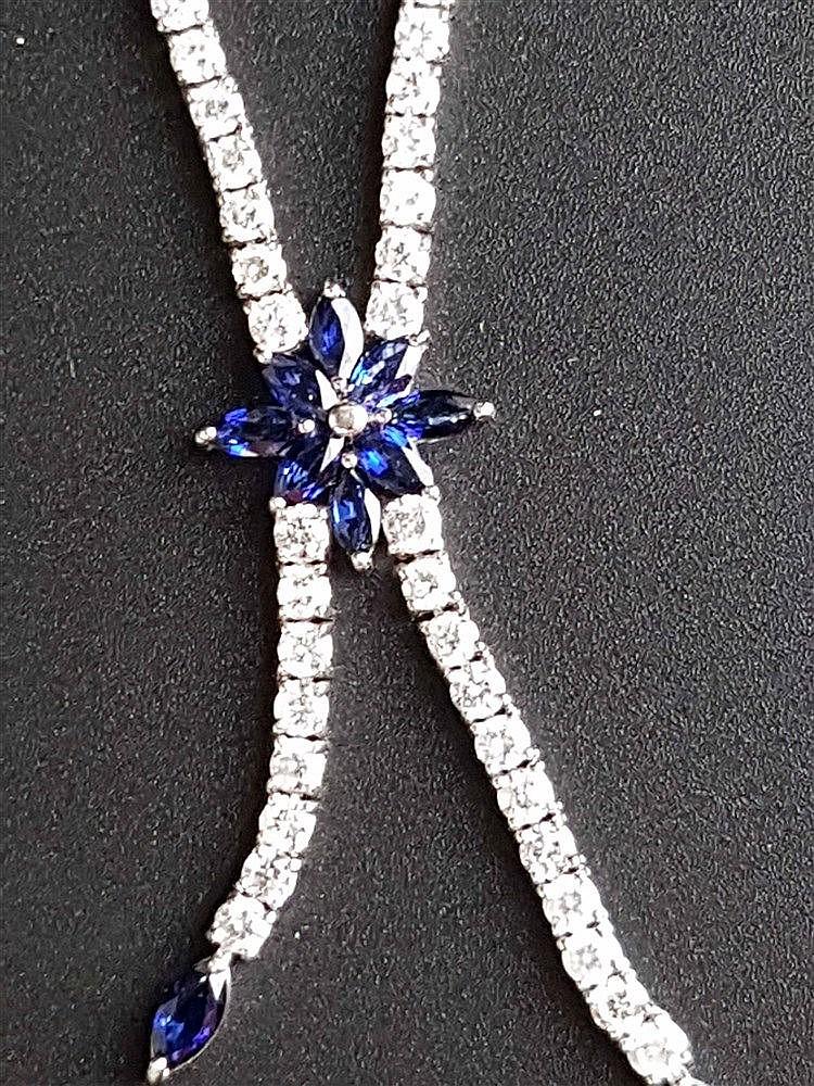 Diamantcollier - Weißgold gestempelt 750,der Länge nach besetzt mit Diamanten im Brillantschliff(zusammen ca.5,54ct.)sowie 10 Saphiren,L.ca.45cm,L(Abhängung).ca.5,5cm ,Zertifikat in englischer Sprache anbei
