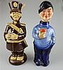 Zwei Figurenflaschen - Flaschen in Form eines Seemannes mit Becher bzw. eines Soldaten in Uniform,Köpfe an Korkstopfen ausgeführt,farbig bzw. monochrom staffiert,H.ca.24,5/25cm