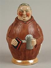 Figurenflasche - Flasche in Form eines beleibten Mönchs in Kutte mit schäumendem Bierkrug und Bibel in beiden Händen,Kopf an Korkstopfen ausgeführt,farbig staffiert, H.ca.19,5cm,am Stand leicht bestossen