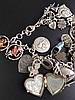 Bettelarmband - 925 Silber-Gliederarmband, mit diversen Abhängungen,ca.25 Stück u.a. alpenländische Motive,meist Silber gestempelt 800/835/925,Tragesp., L.ca.23cm,Ges.Gew.ca.50g