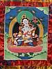Thangka der Sitatara - Tibet, 20. Jh.,Darstellung der weißen Tara im Padmasana auf einer Lotosblüte sitzend,die rechte Hand zeigt das Varada Mudra, die linke Hand hält den Stängel einer voll geöffneten Lotosblüte,Temperafarben auf