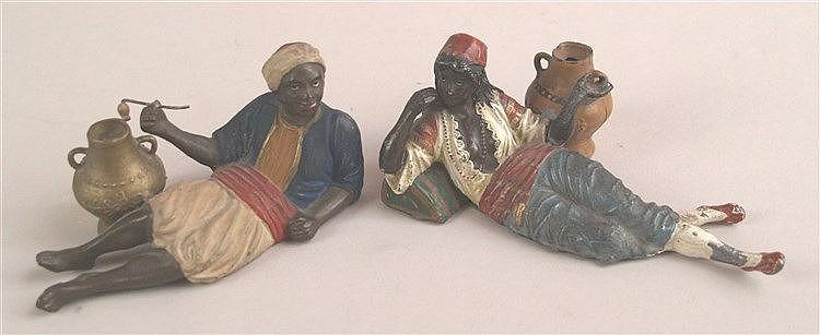 Zwei Metallfiguren - männliche und weibliche Figur im orientalischen Stil, bunt bemalt, Metallguss, wohl Österreich, L.ca.12/14cm, tlw.bestoßen, an Hand restauriert