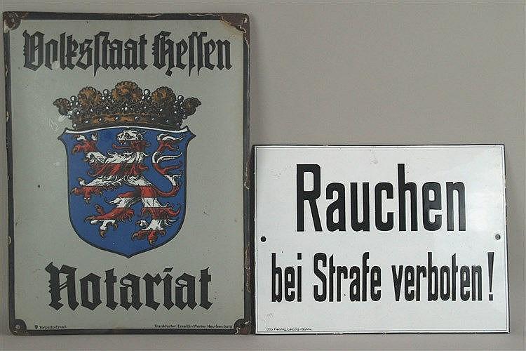 Zwei Emailleschilder - ''Volksstadt Hessen-Notariat'', bunte Farbgebung, ca. 40x30cm, ''Rauchen bei Strafe verboten'', Schwarz auf Weiß, ca.24x32cm