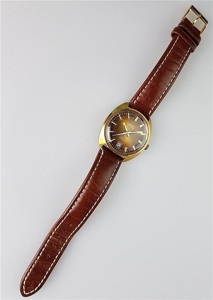 Herrenarmbanduhr - Koha, 17 Rubis, Incabloc, Gehäuse vergoldet, Datum auf der ''6'', braunes Lederarmband, um 1978, Durchmesser ca. 35 mm, Glas mit leichten Kratzern