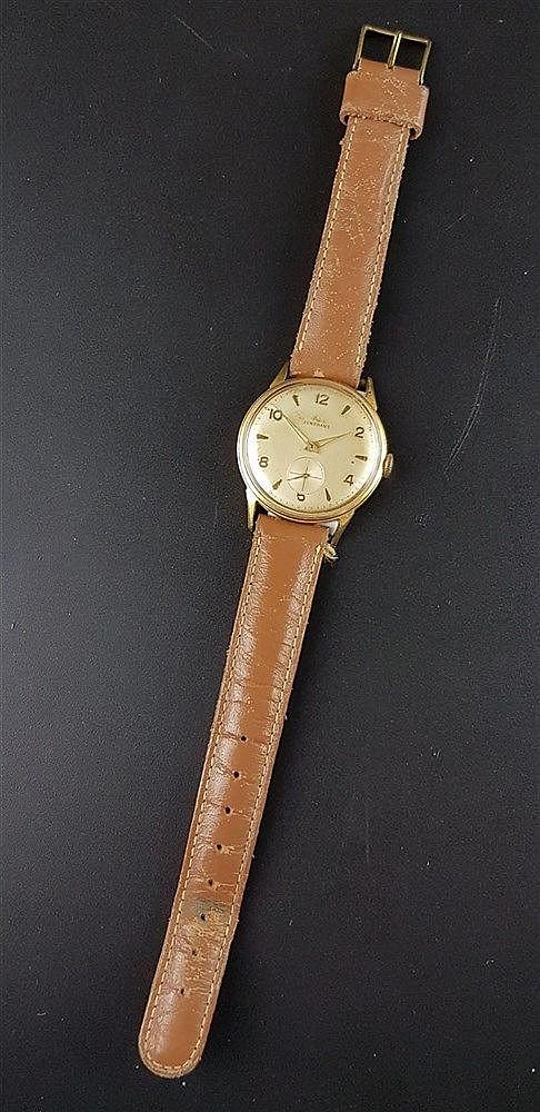 Herrenarmbanduhr, Junghans, vergoldet, braunes Lederarmband, Durchmesser ca. 33 mm