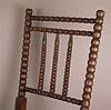 Kinderschaukelstuhl -  um 1900,Holz gedrechselt,trapezförmiger Sitz aus Korbgeflecht,H(Rückenlehne).ca 78 cm,Altersspuren