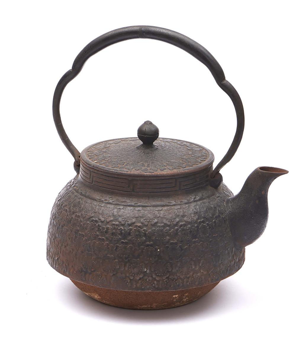 Large iron tetsubin-kettle decorated with blossom flowers in low relief. <b