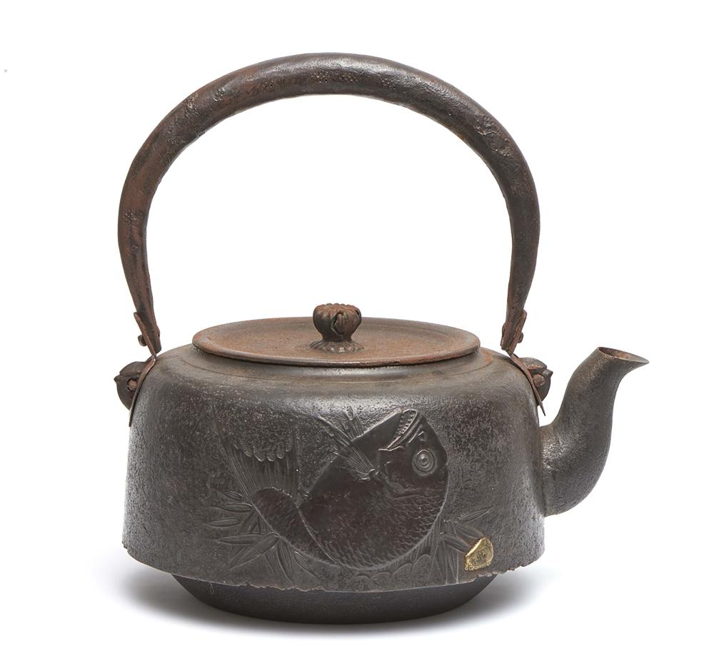 Large iron kettle (tetsubin) with a fixed handle decorated at one side with