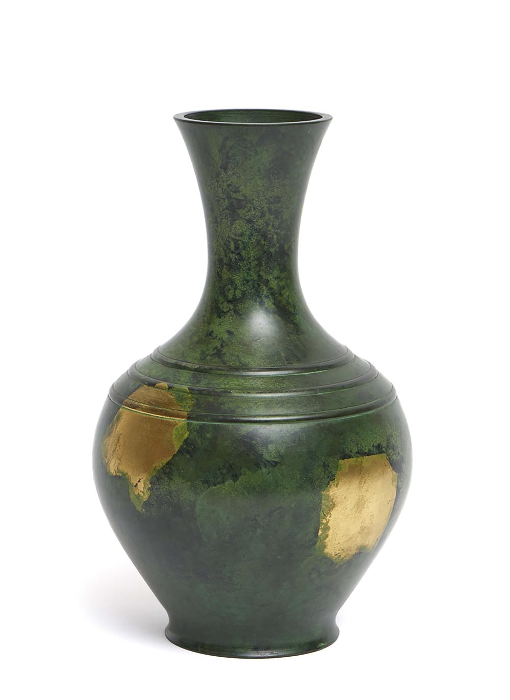 Dark green flask shaped bronze vase decorated with patches of gold. Unclear