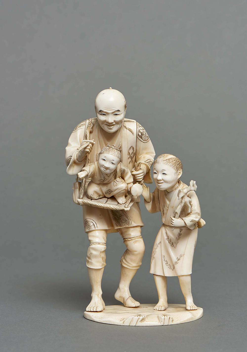 Ivory okimono of man smoking a kiseru-pipe and carrying a small child while