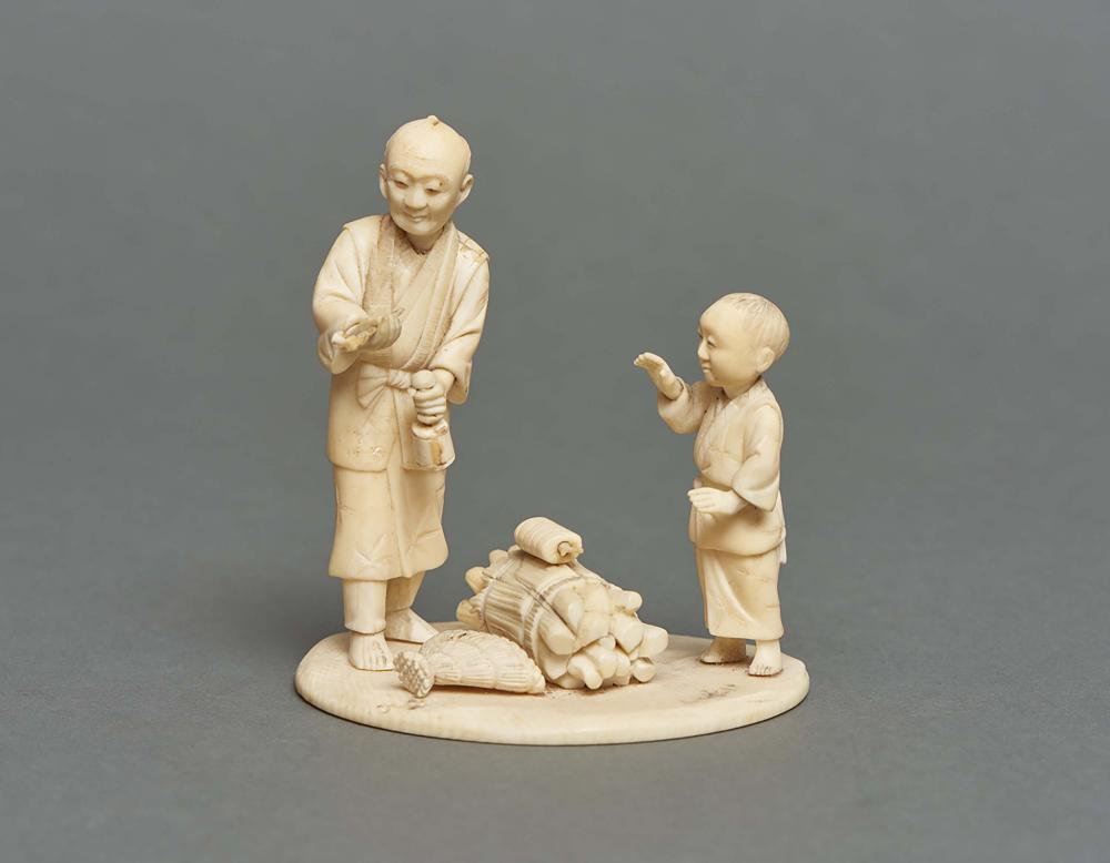 Small ivory okimono of a father and son with between them a bundle of firew