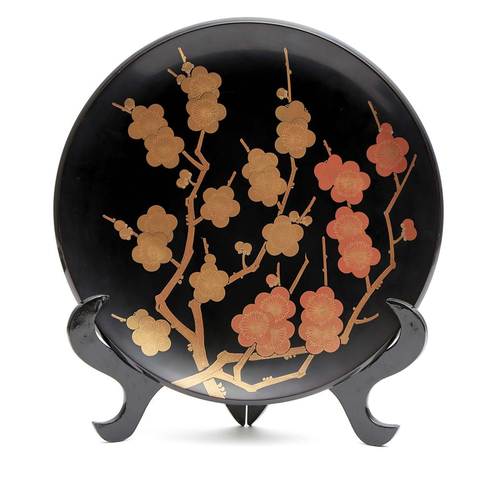 Black lacquered round charger decorated with Japanese apricot blossom in go