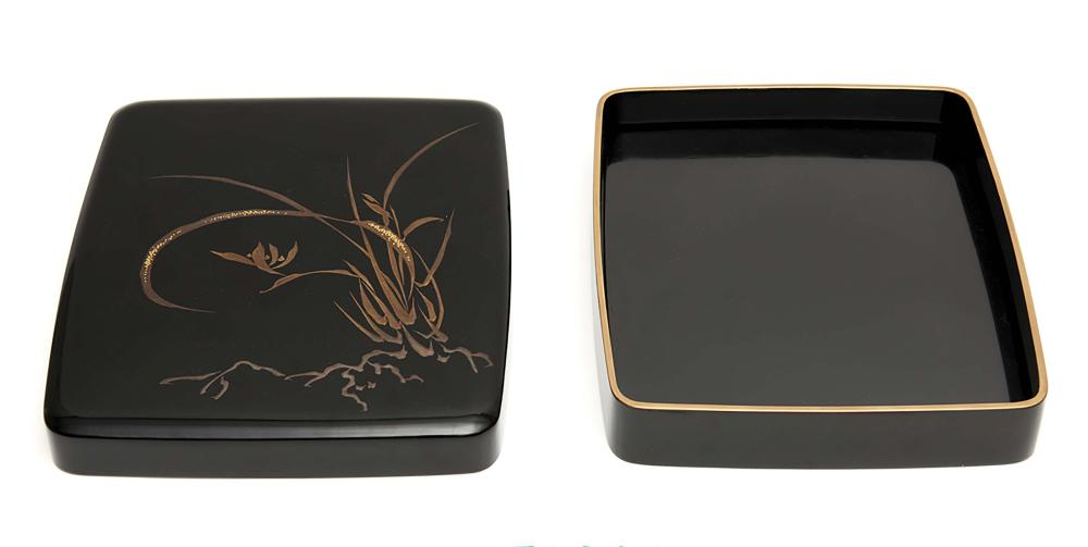 Black lacquered writing box (suzuribako) with rounded corners, its rims gol