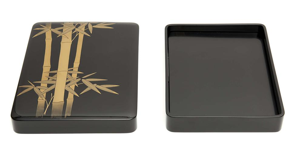 Black lacquered writing box (suzuribako) with rounded corners. On the outsi