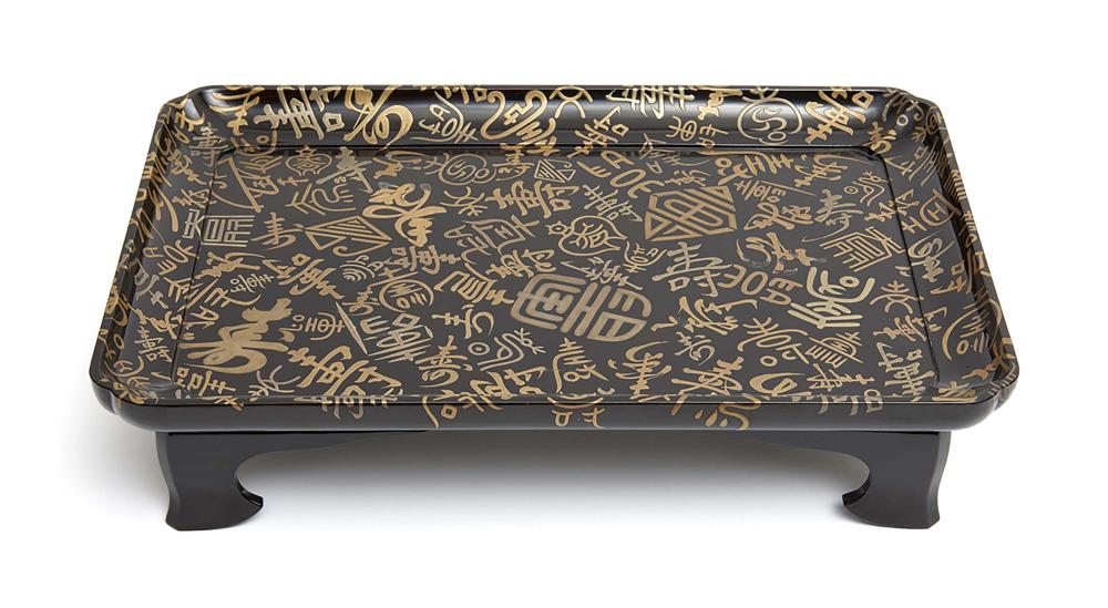Low black lacquered table (zen), its top decorated with various ways of wri