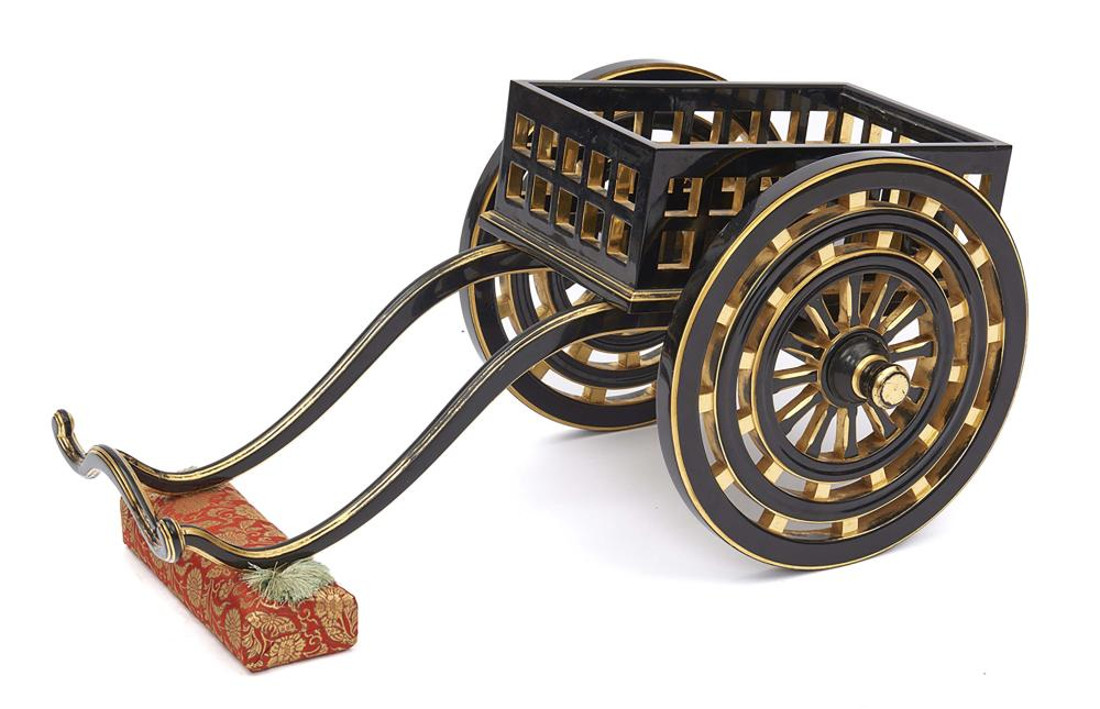Model of a black lacquered two-wheel carriage after the ox carriages used b