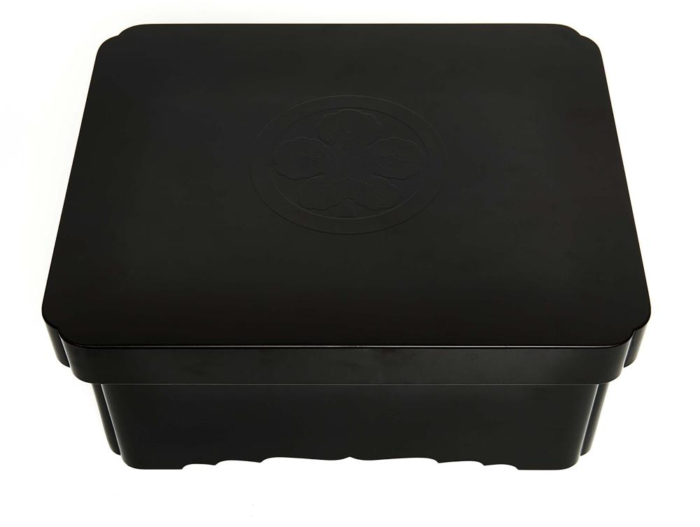 Rectangular black lacquered food container with indented corners, the lid i