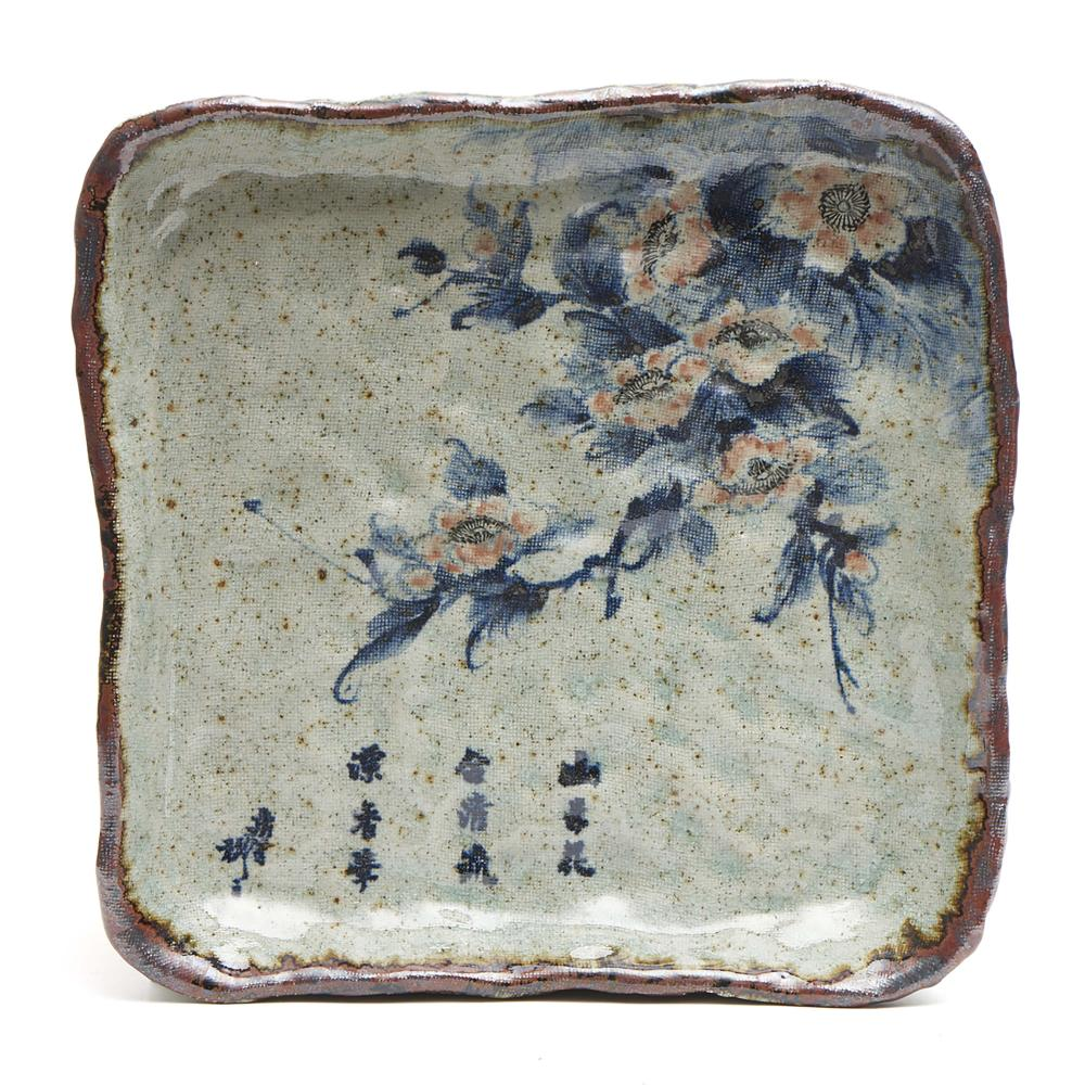 Square stoneware plate decorated with camelia flowers and an inscription, i