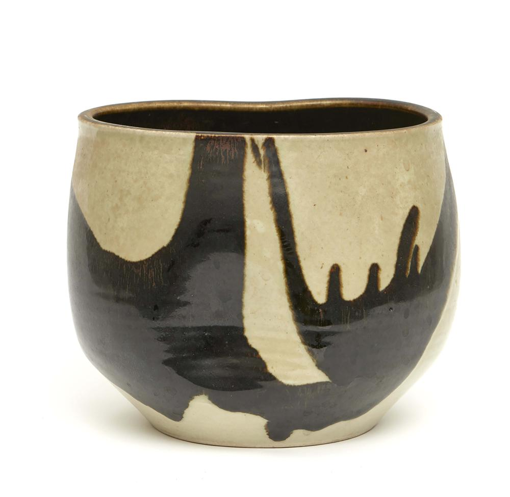 Irregular more or less round bowl shaped vase decorated with a brown-black